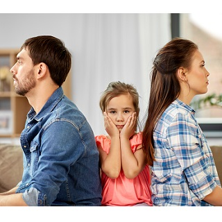 Parents sat facing away from child who is looking upset