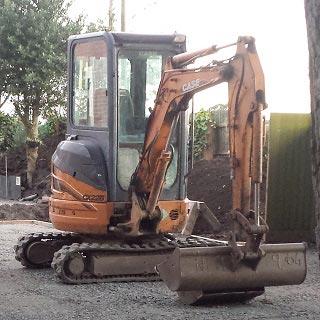 A mini digger at a construction site