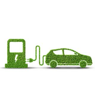 Green car and an electric charging point